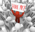 Person Holding Hire Me Sign in Crowd Royalty Free Stock Photography