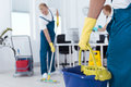 Person holding a mop pail Royalty Free Stock Photo