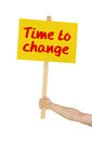 Person holding sign saying time to change a Stock Photography