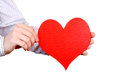 Person holds red heart shape close up isolated on the white background Stock Photos