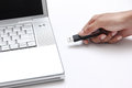 Person inserting a usb drive into a laptop Royalty Free Stock Photo