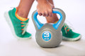 Person lifting kettlebell feet and hand of weight on white background Royalty Free Stock Photo