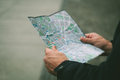 Person looking a map lost Royalty Free Stock Photos