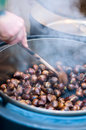 Person makes Roasted Chestnut Stock Photos