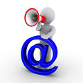 Person with megaphone holding e-mail symbol Royalty Free Stock Photo