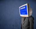 Person with a monitor head and fatal error blue screen on the di display Royalty Free Stock Photography