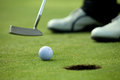 Person playing golf low section Royalty Free Stock Image