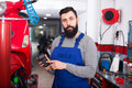 Person is preparing bill for motorcycle repair