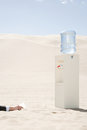Person reaching for water cooler in desert Royalty Free Stock Photo