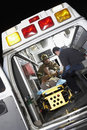 Person receiving medical aid inside ambulance Stock Photos