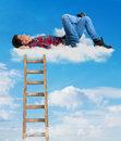 Person relaxing on a cloud Stock Photography