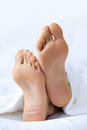 Person s foot in bed close up Stock Photography
