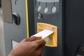 Person`s Hand Inserting Ticket Into Parking Machine Royalty Free Stock Photo
