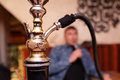Person smoking shisha Royalty Free Stock Photo