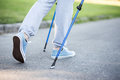Person stepping slowly forward with help of sticks Royalty Free Stock Photo