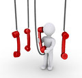 Person talking on phone receiver and others hanging from above Royalty Free Stock Photo