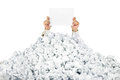 Person under crumpled pile of papers with a blank Royalty Free Stock Image
