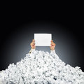 Person under crumpled pile of papers with help si Stock Photo