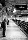 Person waiting for subway alone by traintracks chicago united states may man on platform to arrive at harlem station Stock Photography