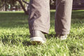 Person walking on green grass. Royalty Free Stock Photo