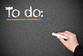 Person writing to do list hand of on blackboard or chalkboard with copy space Stock Photo