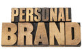Personal brand in wood type isolated text mixed letterpress printing blocks Royalty Free Stock Photo