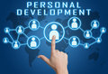 Personal development concept with hand pressing social icons on blue world map background Stock Images