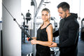 Personal fitness trainer with his client in gym. Royalty Free Stock Photo