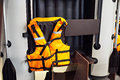 Personal flotation device as life jacket and boat in store Royalty Free Stock Photo