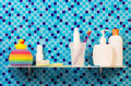 Personal hygiene products on the shelf in  bathroom. Royalty Free Stock Photo