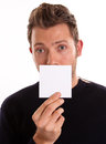 Personal message close up shot of a young man holding a blank note Royalty Free Stock Photos