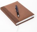 Personal organizer, with pen, on white background. Royalty Free Stock Photo