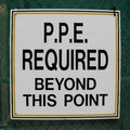 Personal protective equipment (PPE) required beyond this point sign Royalty Free Stock Photo