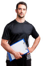Personal traine trainer with a pad in his hand isolated in white Royalty Free Stock Images