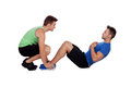 Personal trainer and boy making abdominal isolated on a white background Royalty Free Stock Photography