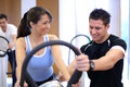 Personal trainer explaining a vibration plate Royalty Free Stock Photo