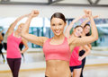 Personal trainer with group in gym fitness sport training and lifestyle concept of smiling people Stock Photo