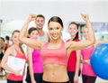 Personal trainer with group in gym fitness sport training and lifestyle concept of smiling people Royalty Free Stock Photo