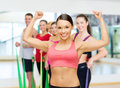 Personal trainer with group in gym fitness sport training and lifestyle concept of smiling people Royalty Free Stock Image