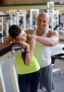 Personal trainer in gym strong Stock Photo
