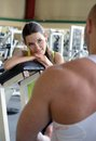 Personal trainer in gym strong Royalty Free Stock Images