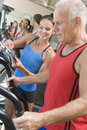 Personal Trainer Instructing Man On Treadmill Royalty Free Stock Photo