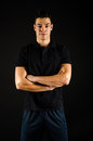 Personal trainer a male standing with his arms crossed Stock Images