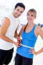 Personal trainer measuring a woman Royalty Free Stock Photography
