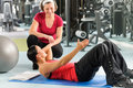 Photo : Personal trainer show abdominal exercise on mat  her her