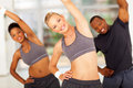Personal trainer workout pretty with two africans on background Stock Photos