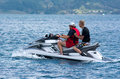 Personal water craft bay of islands nz dec two men rides on dec operating a pwc can involve a risk of body orifice injuries and Royalty Free Stock Photography
