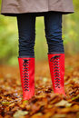Persons legs with bright red boots in the forest Stock Image