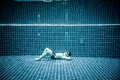 Persons lies under water in a swimming pool man Stock Image