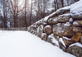 Perspective of beautiful old stone wall, with a misty winter forest in the background. Royalty Free Stock Photo